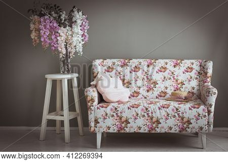 Retro Interior. Green Wall With Floral Sofa And Vase On Wood Floor Old Vintage Retro Interior
