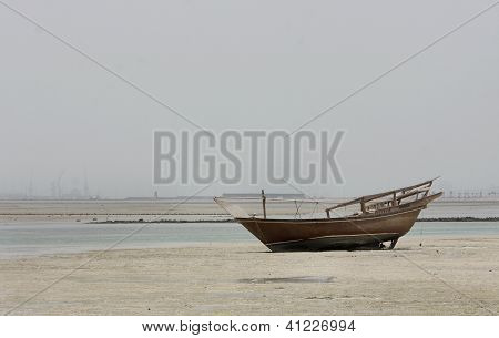 A fishing boat in low tide water