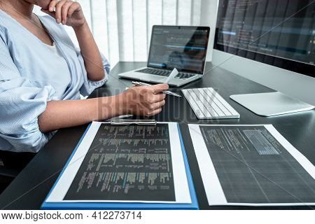 Female Programmer Working In Software Javascript Computer In It Office, Writing Codes And Data Code