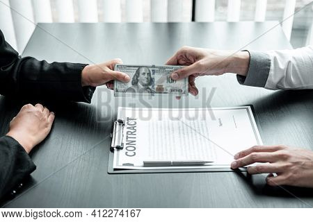 Businessman Giving Bribe Money To Businesswoman To Bribing Deal Contract In A Corruption, Illegal, D