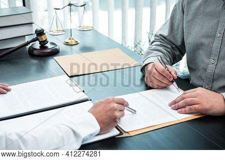 Male Lawyer Discussing Negotiation Legal Case With Client Meeting With Document Contract In Office,