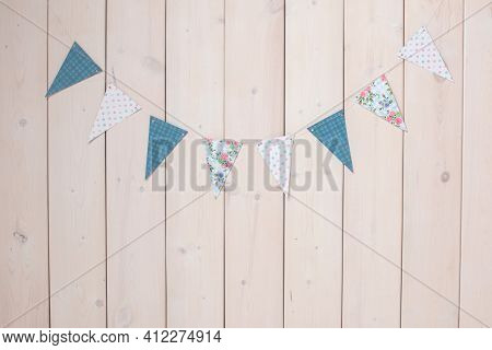 Garland Of Flags On A Wooden Wall. Photozone For Birthday.