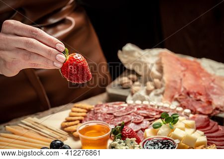Traditional Italian Antipasto. Assorted Cheeses, Grapes, Olives, Prosciutto, Rosemary. Delicious App
