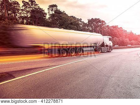 A Big Fuel Tanker Truck , Photo Blur .