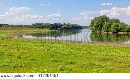 Green Riverside Scenery . Idyllic Scenery With Green River Shore
