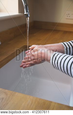A Woman Washing Her Hands With Soap And Antibacterial Wash For 2o Seconds During The Coronavirus Pan