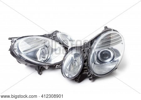 Stylish Xenon Right Headlight Of A German Car - Optical Equipment With A Lamp Inside On A White Isol