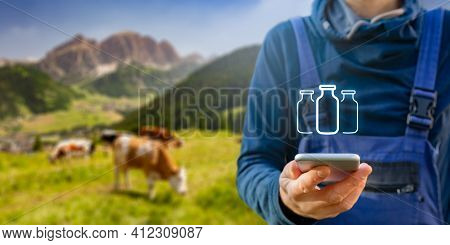 Intelligent Agriculture Concept And Milk Production Control On Smart Phone App. Farmer With Smart Ph