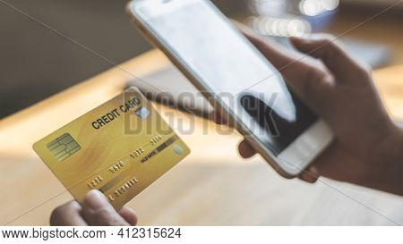 Women use smart phone to register online purchases using credit card payments, Technology for the us
