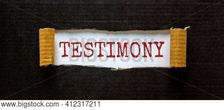 Testimony Symbol. The Word 'testimony' Appearing Behind Torn Black Paper. Beautiful Black Background