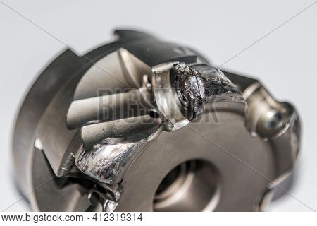 Closeup Of The Damaged Indexable Milling Cutter For Cnc Milling Machine. Photo With Selective Focus