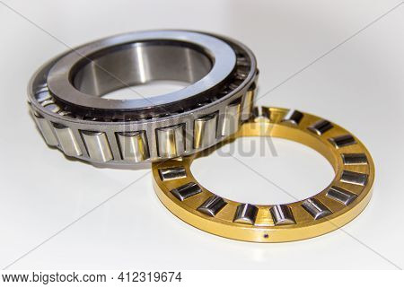 Brass Roller Cage Of A Thrust Roller Bearing And Stainless Roller Cage Of A Tapered Roller Bearing W