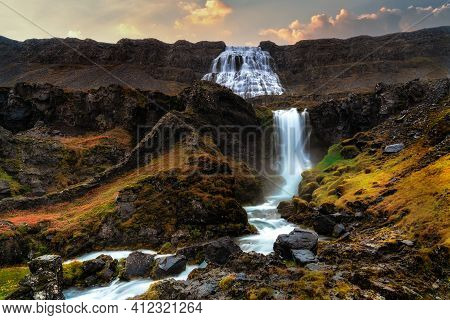 Dynjandi Waterfall With Tiered Waterfalls In The Foreground. Shot During Early Morning Sunrise Durin