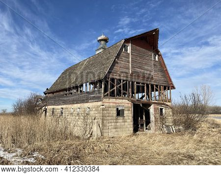 Old Abandoned Livestock Barn Nestled Away On A Vacant Farm In Western Minnesota