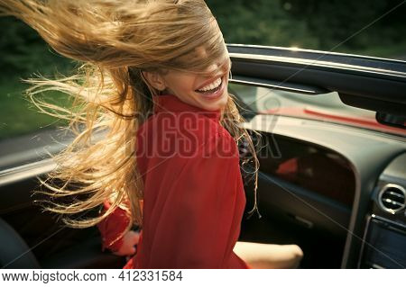Advertising Perfume. Businesswoman Or Pretty Woman In Convertible Car. Close-up Female Model Driving