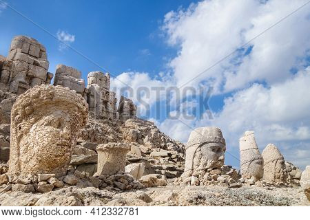 Heads Of Statues Of Ancient Gods On Mount Nemrut, Kahta, Turkey. Statues Was Built In 1 Century Bc B