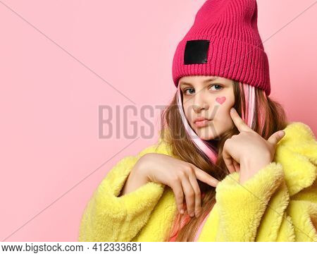 Close Up Portrait Of Modern Bright Confident Teen Girl On Pink Background. Child With Pink Strands O