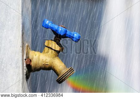 Brass water end of line valve outside with artificial rain and rainboe