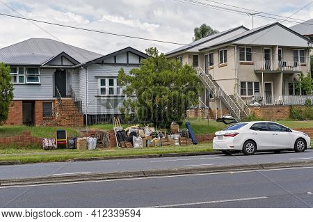 Brisbane, Queensland, Australia - March 2021: Unwanted Household Goods Placed At The Curb For Public
