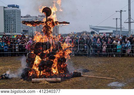 Minsk, Belarus - March 13, 2021: Celebration Of Maslenitsa. Burning Effigy Made From Straw On Tradit