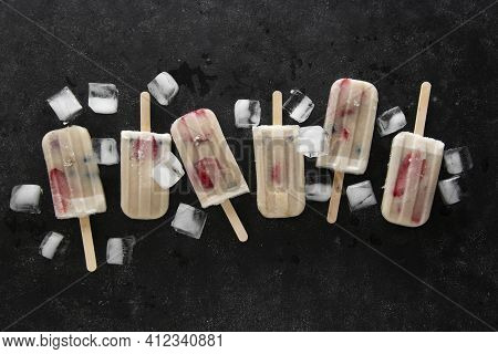 Homemade Lolly Ice Cream With Strawberries, Blueberries And Bananas. Black Background. Top View.