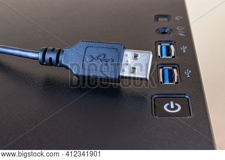 Usb Cable Near Two Ports On The Top Of A Modern Computer Tower Case. Information Transfer And Storag