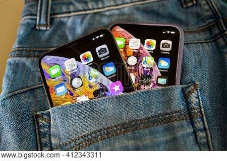 Paris, France - Sep 29, 2018: Rear View Of Denim Jeans Rear Pocket With New Apple Computers Smartpho