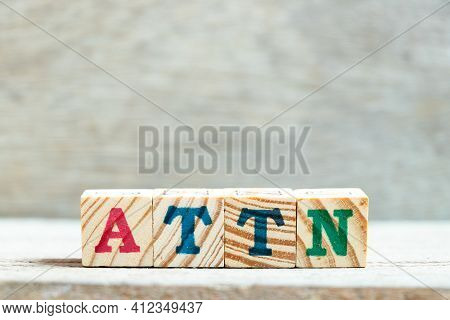Alphabet Letter Block In Word Attn (abbreviation Of Attention) On Wood Background