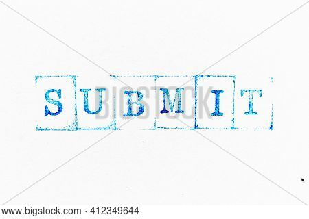 Blue Color Ink Rubber Stamp In Word Submit On White Paper Background