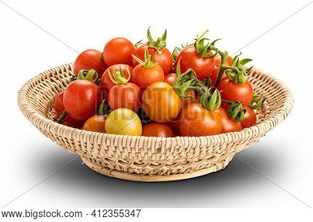 Closeup View Pile Of Freshly Harvested Ripe And Juicy Tomatoes In Bamboo Basket Isolated On White Ba