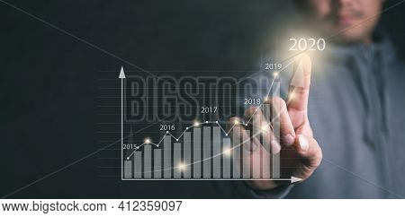 Man Touching On Screen.plans To Increase Business Growth And An Increase In The Indicators Of Positi