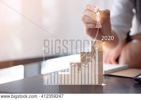 Woman Use Pen Plans To Increase Business Growth And An Increase In The Indicators Of Positive Growth