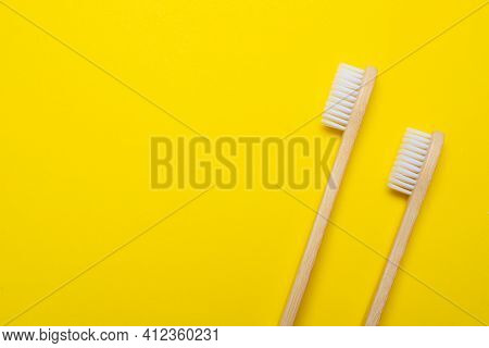Bamboo Brush On A Yellow Background. No Plastic. Ecology. Taking Care Of The World Around You. Tooth