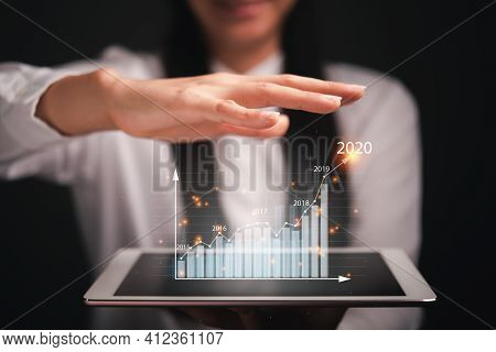Business Analytics And Financial Technology Concept, Virtual Screen Chart From The Screen Of Digital