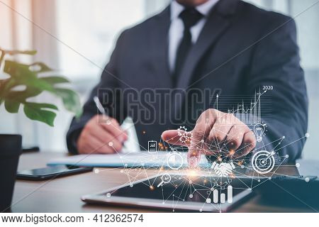 Businessman Using Tablet Analyzing Sales Data And Economic Growth Graph Chart .e-commerce And Networ