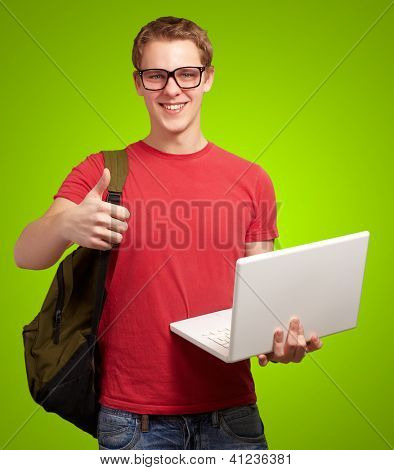 man holding laptop and backpack isolated on green background