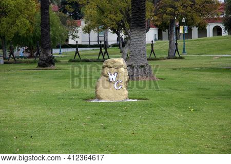 March 12, 2021 - Whittier, California: Whittier College. The Rock. Placed in June 1912, Three Senior Men placed the Rock as a Most Lasting Gift at the entrance to Whittier Collage. Editorial use only