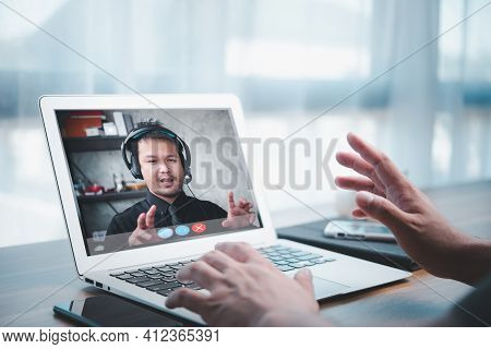 Asian Business Man Making Facetime Video Calling Using Online Meeting Via Laptop Computer At Home Of