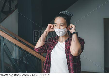 Young Smart Asian Female Wearing Face Mask During Coronavirus Covid-19 Outbreak. Virus Spread Flu Pr