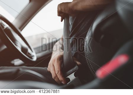 Male Hand Fastens The Seat Belt Of Car. Close Your Car Seat Belt While Sitting Inside The Car Before