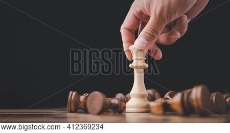 Male Hand Moving Chess Piece On Chess Board Game Concept For Ideas And Competition And Strategy, Bus
