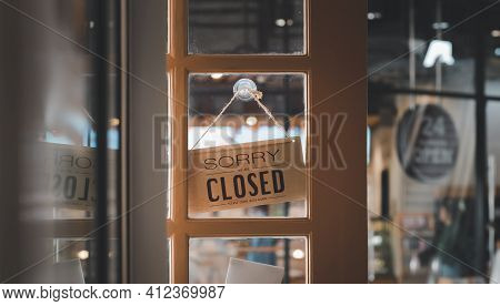 Closed Sign In A Shop Showroom With Reflections. Sign Showing The Word