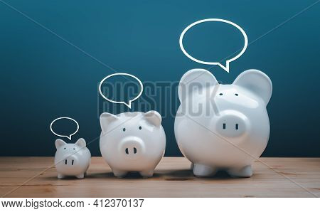 Income Management, Expenses, Invest, Save, Three White Ceramic Piggy Bank On Wood Table. Family Pigg