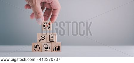Business Strategy, Action Plan, Goal And Target, Hand Stack Woods Block Step On Table With Icon Abou