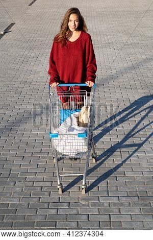 Consumerism, Sale And Discount. Happy Woman With Shopping Cart Outdoor