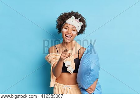 Haha Look At This. Glad Curly Haired Ethnic Woman Smiles Broadly Points Finger At You Laughs Over So