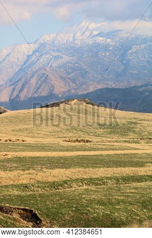 Windswept Grasslands On A Rural Plateau With Snow Capped Mt San Jacinto Beyond Taken At A Prairie In
