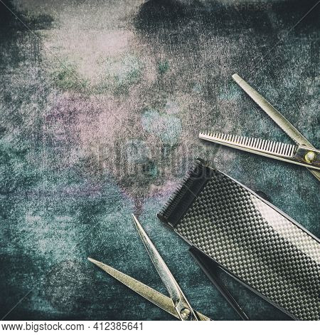 Barber Scissors, And A Hair Clipper, On A Dark, Shabby Grunge Background. Copy Space. Beauty And Fas