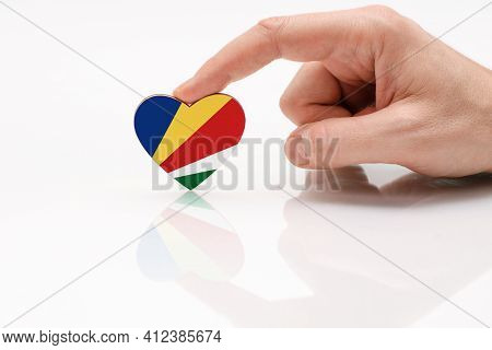 Seychelles Flag. Love And Respect Seychelles. A Man's Hand Holds A Heart In The Shape Of The Seychel