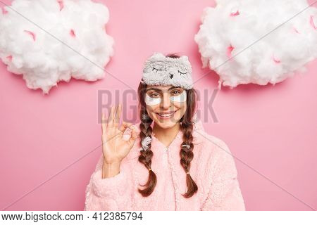 Pretty Brunette Caucasian Woman Smiles Gently Shows Okay Gesture Likes Something Applies Collagen Pa